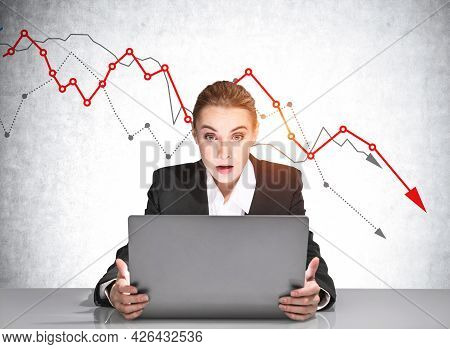 Surprised Businesswoman Trader Wearing Suit Is Sitting At Workplace Looking At Laptop Screen And Exp