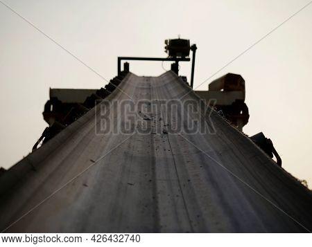 Conveyer Belt Concrete Mixer Machine Presenting White Sky Industrial Background.