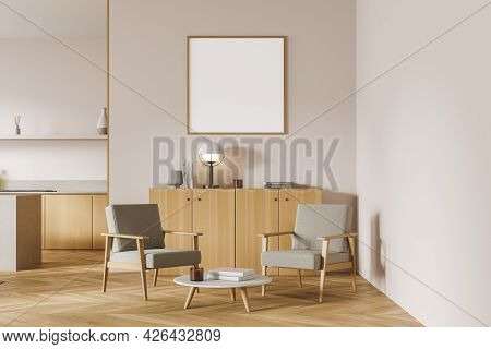 Poster In The Waiting Room Area Of Light Studio Kitchen With Pinky White Walls. Armchairs With Coffe