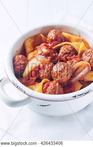 Pappardelle Pasta With Tomato Sauce And Meatballs On Bright Background. Close Up.