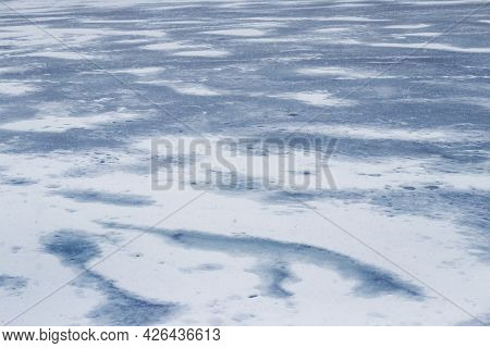 Texture Of Snow-covered Ice On The River After A Blizzard. Winter Background