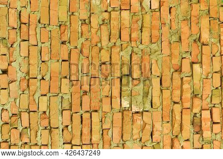 Brick Wall. Decorative Wall Made Of Red Bricks. Background For Design On A Construction Or Architect