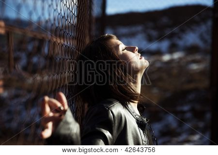 Emotional young woman portrait on urban blurry environment