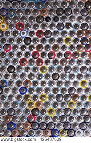 A Lot Of Old Aaa Batteries Lined Up In A Row