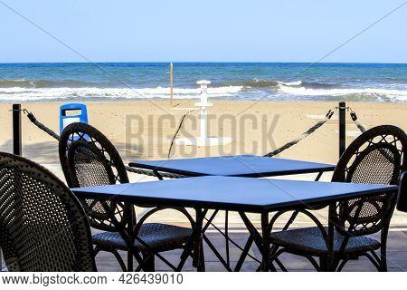 Bar With Empty Terrace On Santa Pola Beach On A Sunny Day