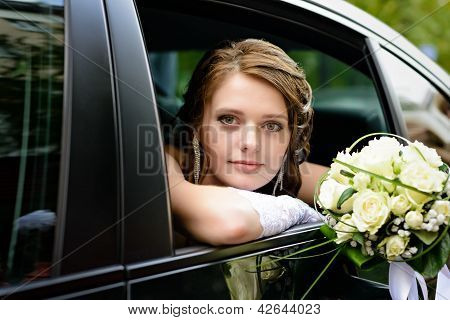 Portrait Bride In A Car Window