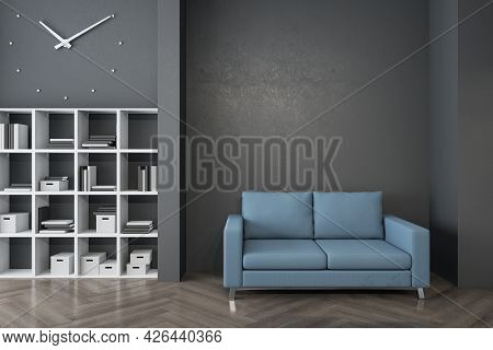 Modern Waiting Area In Office With Bookcase, Comfortable Blue Couch, Wooden Flooring And Empty Mocku