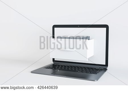 Close Up Of Laptop Computer With Abstract Document Folder Coming Out Of Screen On White Background.