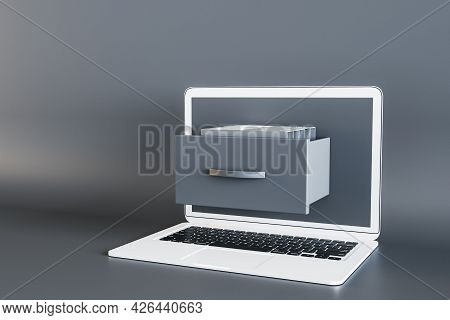 Close Up Of Laptop Computer With Abstract Document Folder Coming Out Of Screen On Grey Background. C