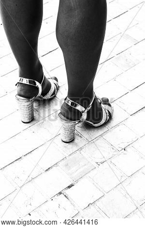 Voluminous Women With Party Heels. Monochrome Picture.