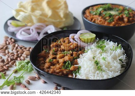 Red Kidney Beans In A Thick And Spicy Gravy Of Onions And Tomatoes Served Along With Steamed Basmati