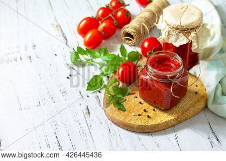 Tomato Paste, Home Preservation. Tomato Sauce Made From Ripe Tomatoes On A Wooden Tabletop. Copy Spa