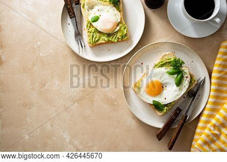 Keto Breakfast. Avocado Toast With Fried Eggs And Fresh Green Peas, Coffee Cups. Copy Space For Text