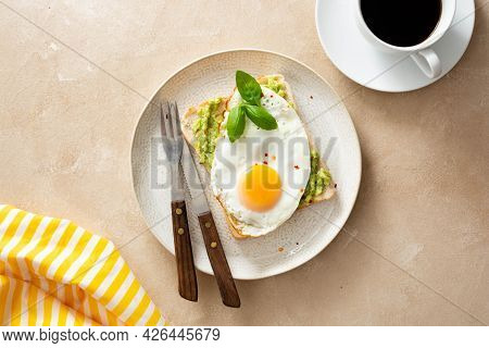Delicious Breakfast. Avocado Toast And Fried Egg. Healthy Food, Flatlay.
