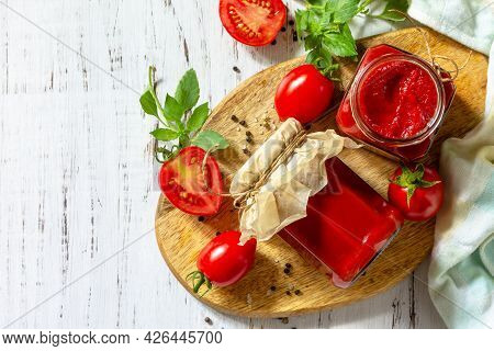 Tomato Paste, Home Preservation. Tomato Sauce Made From Ripe Tomatoes On A Wooden Tabletop. Top View