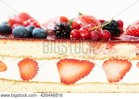A Piece Of Cake In The Cut. Berry Cake With Strawberry Slices.