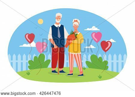 Elderly Couple Is Standing With Flowers With Blue Sky On The Background. Happy Family, Old Grey Spou