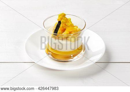 Creamy Panna Cotta With Mango And Vanilla In Glass