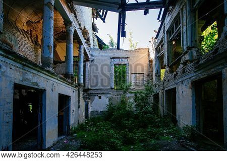 Ruined Mansion Hall Interior Overgrown By Plants. Nature And Abandoned Architecture, Green Post-apoc