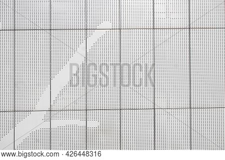 Fragment Of A Steel Wall With Holes