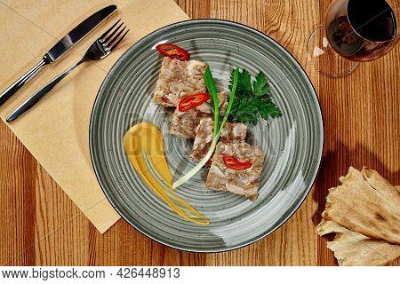 Georgian Jellied Pork Mujuji With Mustard, Shotis Puri And Wine