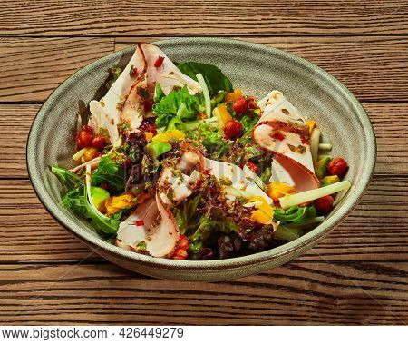 Salad Of Greens With Avocado, Mango, Baked Ham And Fried Chickpeas