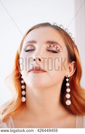 Vertical Portrait Of A Close-up Of A Red-haired Woman With Closed Eyes With Makeup Made Of Pearls, A