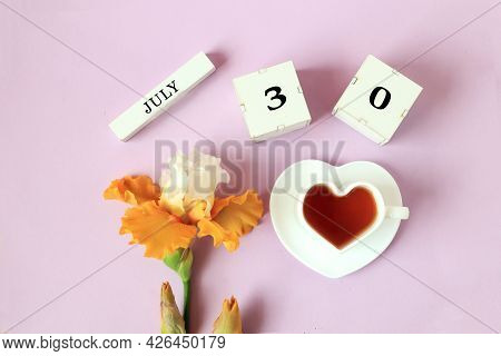 Calendar For July 30 : The Name Of The Month Of July In English, Cubes With The Number 30, A Cup Of