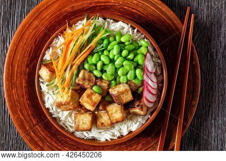 Tofu Poke Bowl With Basmati Rice, Edamame Beans, Radish, Thinly Sliced Cucumber And Carrots Salad In
