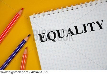 Equality Word Written On White Notepad And Yellow Background