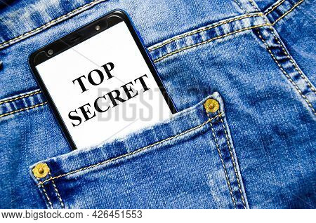 Top Secret The Text Is Written On The White Screen Of The Phone Shortly Lies In Jeans
