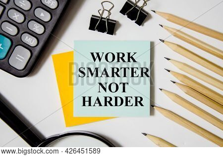 Word Smarter Not Harder Written On Yellow Sticker And White Background Near Office Supplies