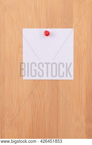White Sticky Note With Copyspace Pinned To The Wooden Message Board. To Do List Reminder In Office.