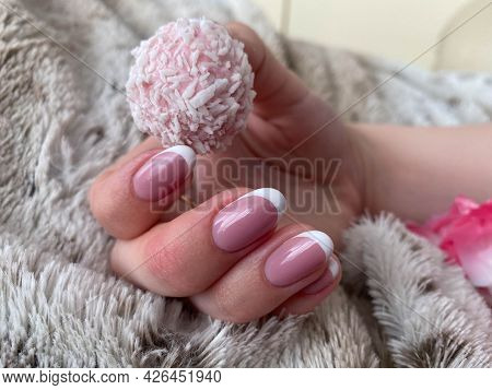 A Beautiful Female Hand With Pink Nails And Manicure Is Holding A Beautiful Pink Delicious Sweet Can