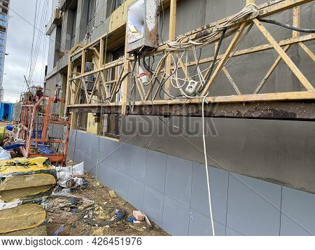 Finishing The Facade Of A Monolithic Building Made Of Concrete And Gas Silicate Blocks With Mineral