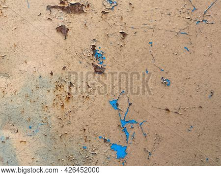 Yellow And Blue Old Scratched Metal Sheet, Iron Rusty Surface With Peeling Paint. The Background. Te