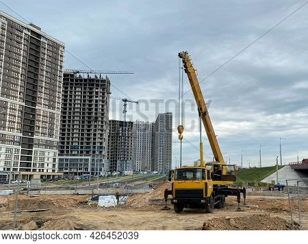 Large Yellow Mobility Modern Industrial Construction Crane Mounted On A Truck Is Used In The Constru