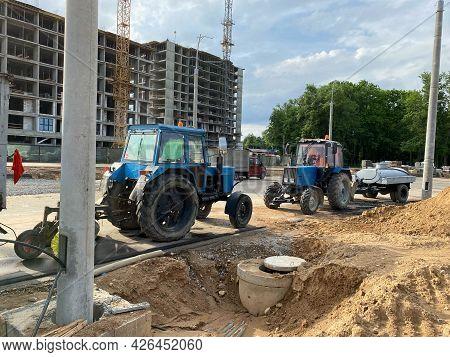 Big Blue Powerful Tractors, Asphalt Paving And Road Repair Machines At A Construction Site. Construc