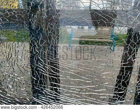 Beautiful Broken Anti-vandal Transparent Shiny Cracked Glass. The Background. Texture