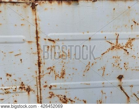 Gray Old Scratched Sheet Of Metal, Iron Rusty Surface With Peeling Paint. The Background. Texture
