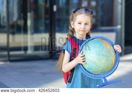 Beautiful Kid Back To School. Happy Cute Clever Confident Girl With In Blue Dress. Smart Schoolchild