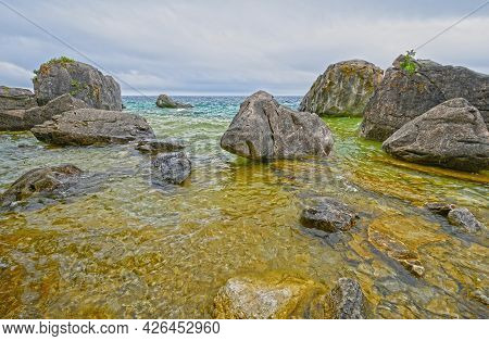 Rocks Growing Out Of The Waters On Lake Huron In Bruce Peninsula National Park In Ontario