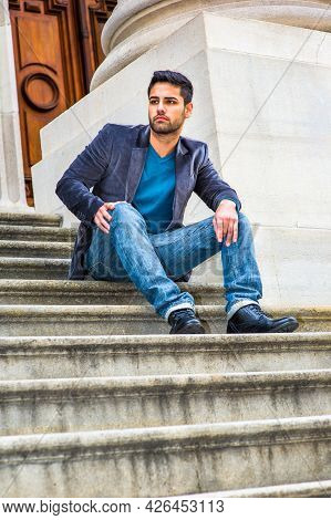 Dressing In A Dark Purple Woolen Blazer,  Blue Jeans And Black Leather Shoes, A Young Middle Eastern