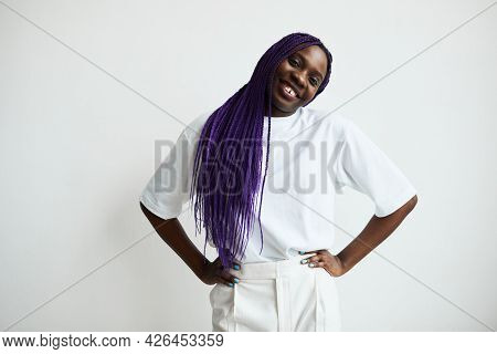 Minimal Waist Up Portrait Of Contemporary African-american Woman With Colored Hair Smiling At Camera