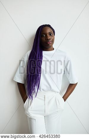 Minimal Waist Up Portrait Of Contemporary African-american Woman With Colored Hair Looking At Camera