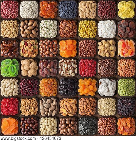 Assorted Nuts And Dried Fruits. Mix Nuts In Wooden Bowls. Collection Nuts Background