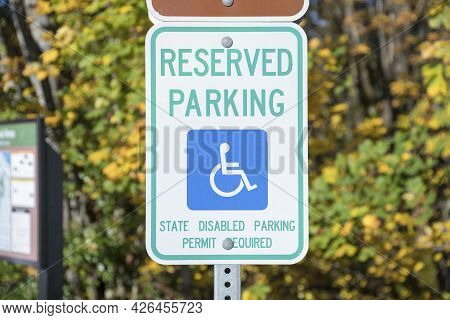 Reserved Parking For A Person With Disability Signage On A Metal Post At Tacoma In Washington