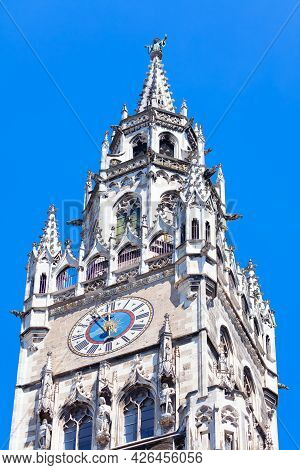 Spire With Horology Of Munich Rathaus , Bavaria Germany . Top Of New Town Hall In Munich
