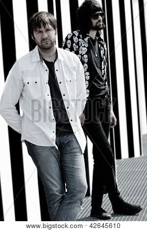 PARIS, FRANCE - APRIL 25, 2008: Portrait of the british rock group Kasabian with Tom Meighan and Sergio Pizzorno at Paris, France on april 25th, 2008