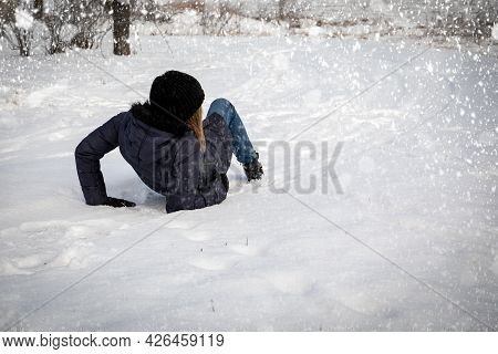 Slip On The Slippery Ice And Snow On The Road. Snowfall And Weather